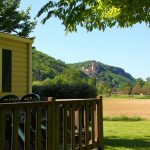 Mobile homes with view to a Castle at camping maisonneuve - dordogne - perigord noir
